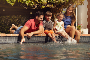 Family Having Fun By Their Swimming Pool